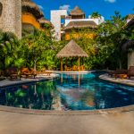 What are the benefits of investing in Tulum houses? Discuss a few of them